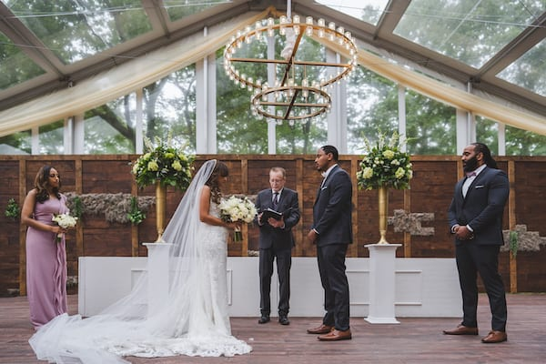 bride and groom exchanging wedding vows at Cescaphe's Franklin's View wedding venue in Old City Philadelphia