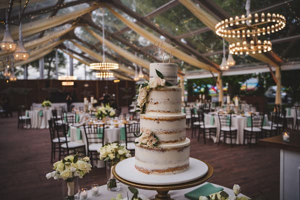 four-tiered naked wedding cake at Cescaphe's Franklin's View wedding venue