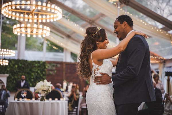 couple's first dance under the clear tent at Cescaphe's Franklin's View wedding venue