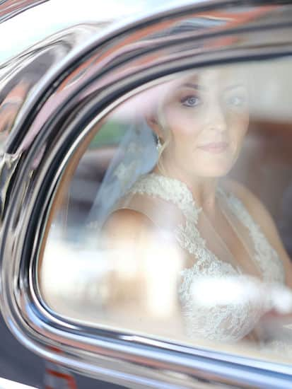bride riding to her wedding in a vintage car