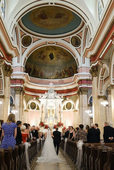 bride and her father walking down the aisle at The National Shrine of St Rita of Cascia in Philadelphia