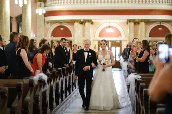 bride and her father walking down the aisle at St Rita's in Philadelphia