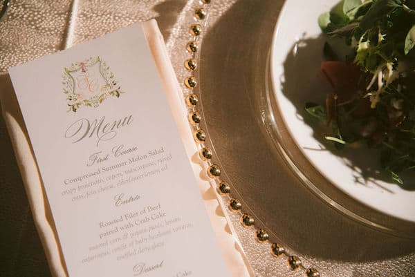 custom menu cards and a salad on a gold rimmed charger plate at a wedding in Hamilton Hall at Philadelphia's Please Touch Museum