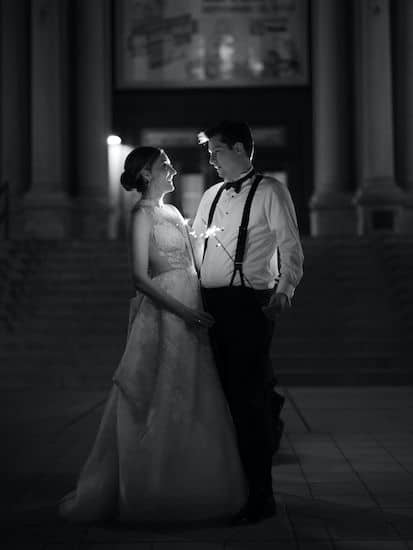 bride and groom with sparklers outside Philadelphia's Please Touch Museum